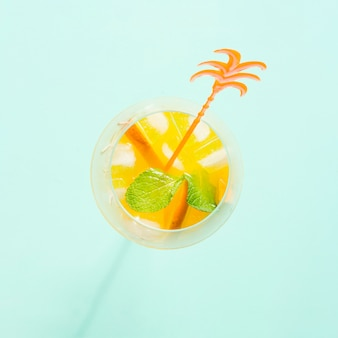 Cocktail with orange, mint and ice