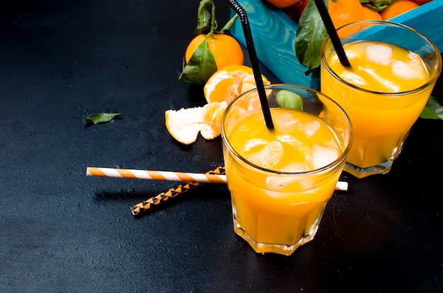 Cocktail with tangerines, juice and ice