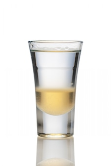 Cocktail with three layers of alcohol in shot glass isolated on white
