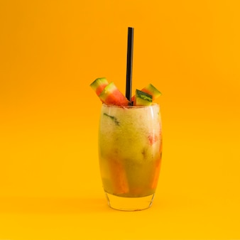 Cocktail with watermelon slice on yellow background