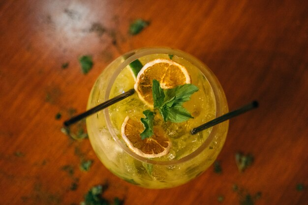 Cocktail yellow with lemon and mint