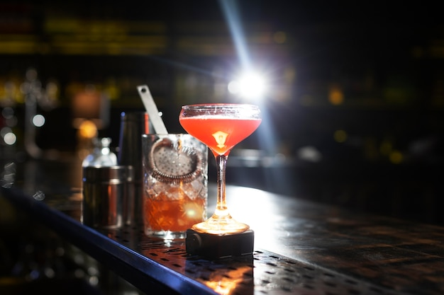 Cocktails and shaker arrangement in a night club