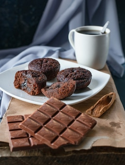 Cocoa brownies and chocolate bars with a cup of tea