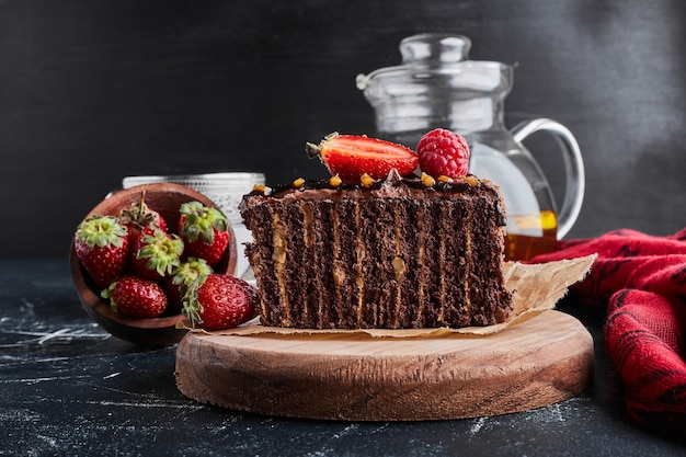 Cocoa crepe cake with strawberries.