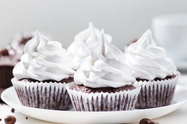 Cocoa cupcakes with meringue cream