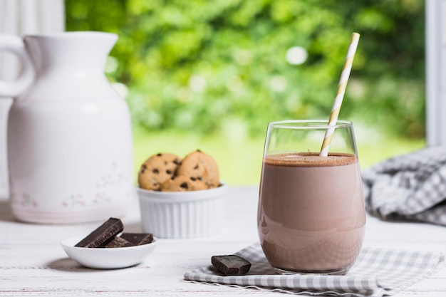 Cocoa in glass on table