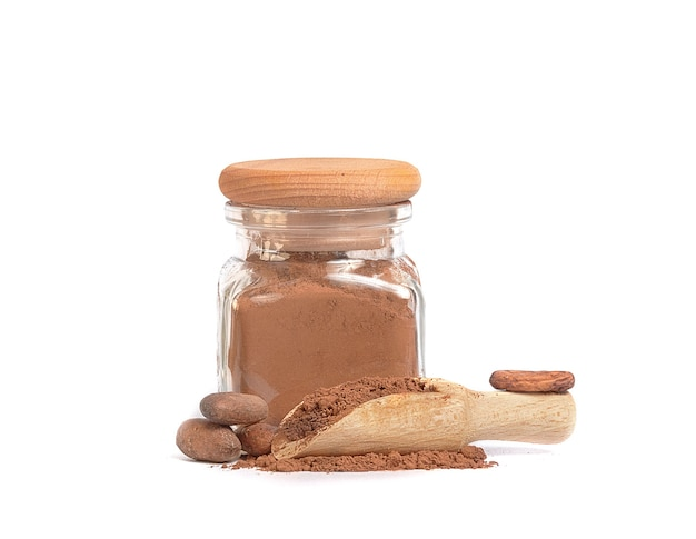 Cocoa powder in glass jar and cocoa beans