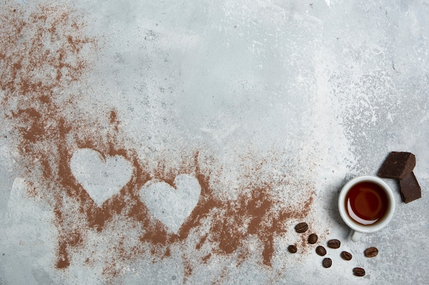 Cocoa powder hearts copy space