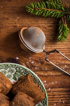 Cocoa powder and strainer flat lay