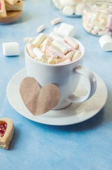 Cocoa with marshmallows and a cookie heart. selective focus.