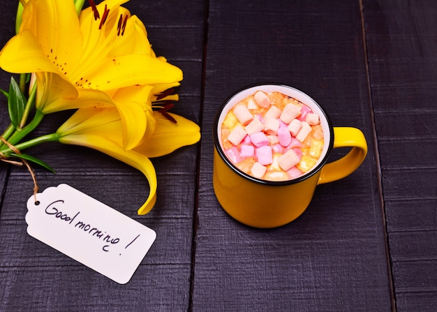 Cocoa with marshmallows in a yellow mug