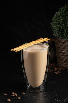 Cocoa with salted straws in a transparent two-layer thermo glass.