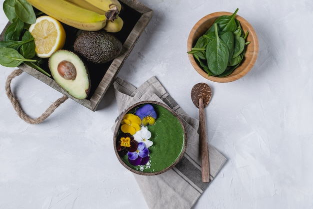 Coconut bowl with green fruit smoothie