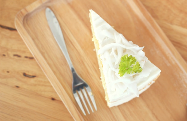 Coconut cake on wooden table from top view shot