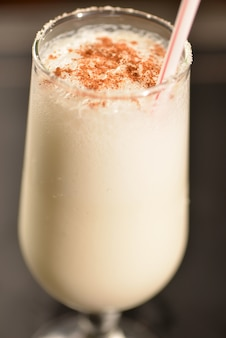 Coconut cocktail with cinnamon and crystallized sugar