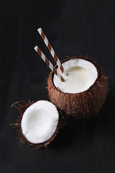 Coconut cocktail with straw. tropical drink