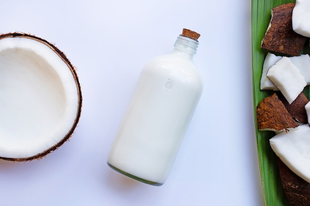 Coconut and coconut milk on white background.