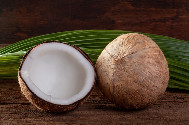 Coconut and coconut milk on wooden background.