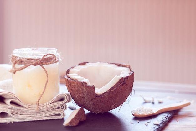 Coconut and coconut oil in a bottle