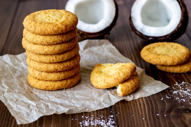 Coconut cookies on a brown wooden. coconuts.