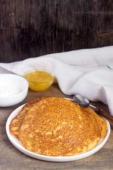 Coconut corn pancakes with honey. rustic style.