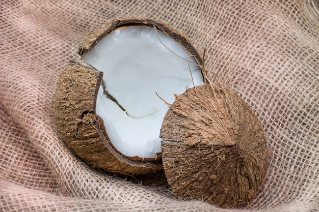 Coconut fresh coconut on textured brown background healthy food concept