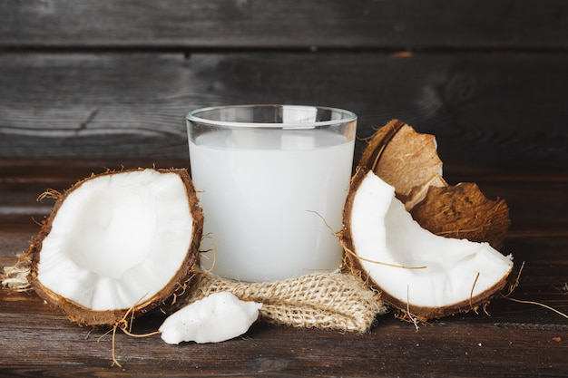 Coconut and glass jug with coconut milk