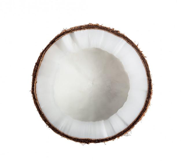 白で隔離されるココナッツ半分