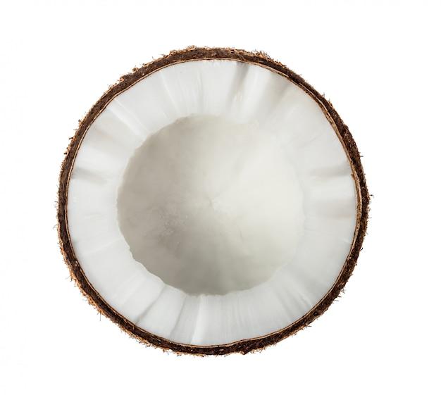 白い壁に半分のココナッツ