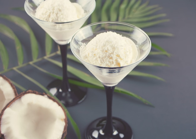 Coconut ice cream on the with palm leaf and coconut