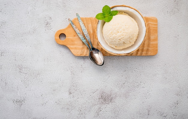 Coconut ice cream with spoons on a concrete table