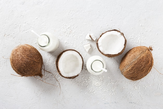 Coconut milk in bottles top view. healthy eating concept top view