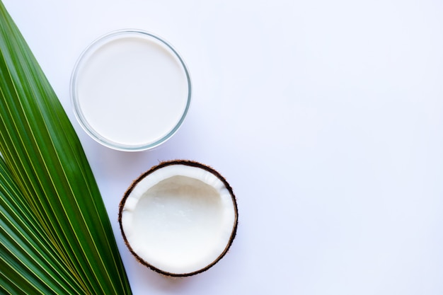 Coconut milk and coconut on  white background