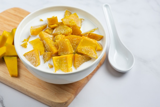 Coconut milk stewed pumpkin in white bowl
