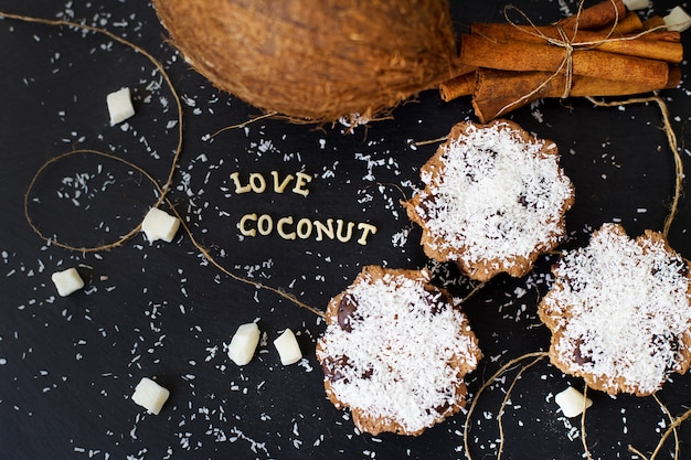 Coconut muffins on a black background