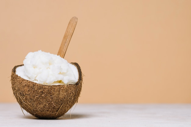 Coconut oil in coconut bowl with copy-space