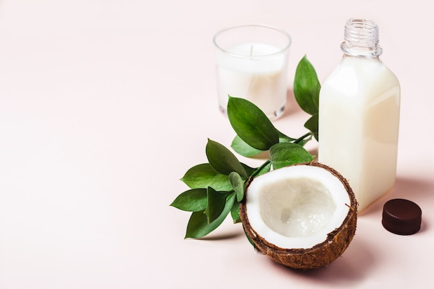 Coconut oil and tropical leaves. hair care spa concept.