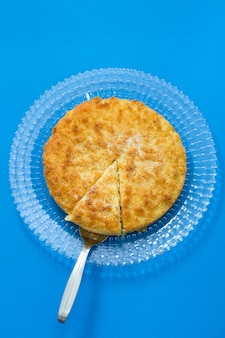 Coconut tarte on plate in blue background