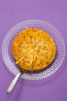 Coconut tarte on white plate in blue background