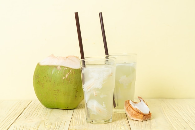 Coconut water or coconut juice in glas with ice cube
