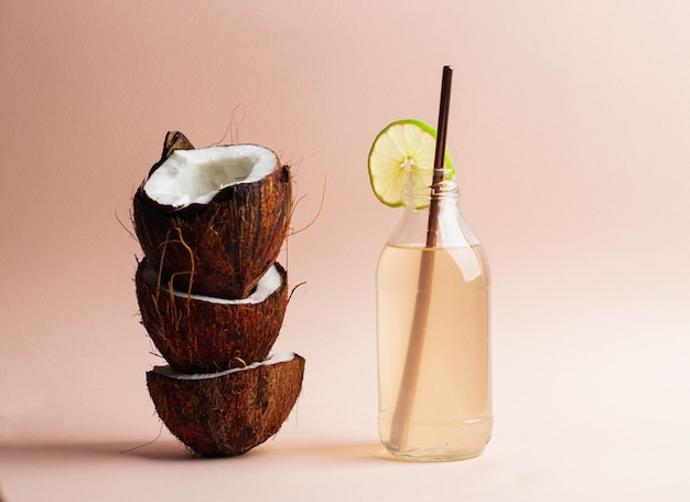 Coconut water in glass bottle with lime.