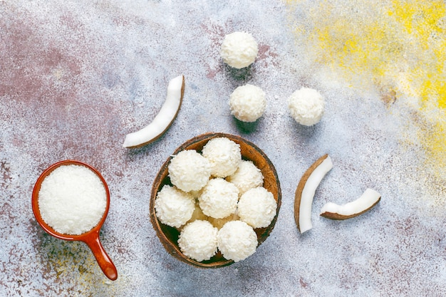 Coconut and white chocolate truffles with half coconut