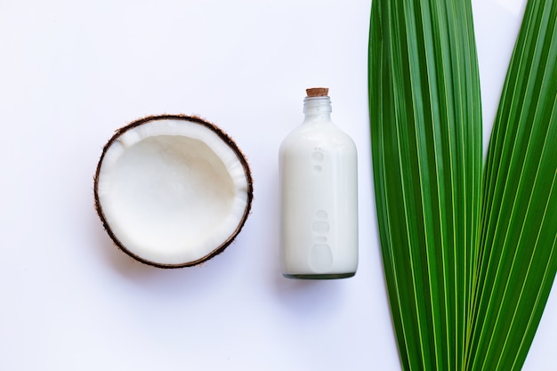 Coconut with coconut milk on white