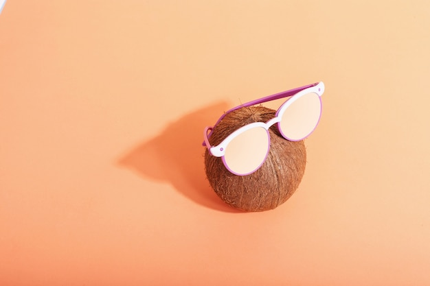 Coconut with glasses, morning is a tough shadow from the sun.
