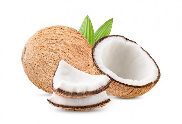 白い壁の葉とココナッツ。