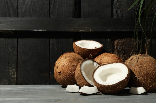 Coconut on wood, space for text. tropical fruit
