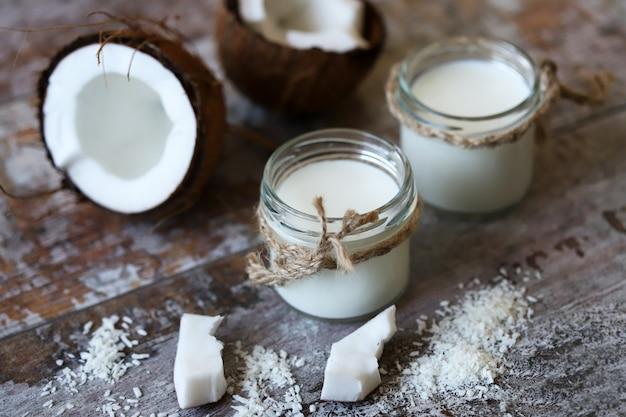 Coconut yogurt vegan food. coconut and coconut flakes.