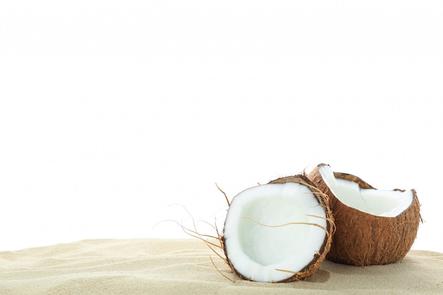 Coconuts on clear sea sand isolated on white background. summer vacation