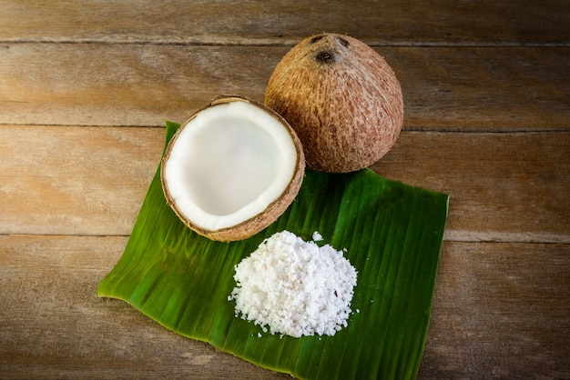 Coconuts and coconut flakes on banana leaf