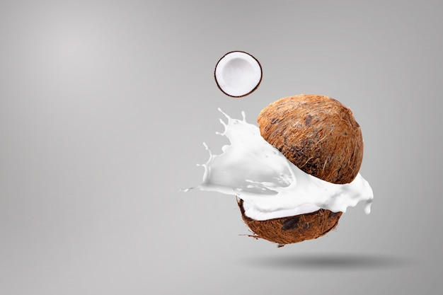 Coconuts and coconut milk splashing